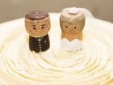 funny wine cork wedding cake toppers showing a groom in black and a bride in white can be DIYed
