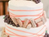 a wedding cake topped with wine corks and grapes will fit a vineyard wedding easily