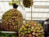 colorful wine cork balls hanging over the reception is a fun and cool wedding decor idea