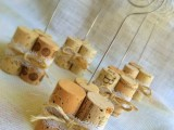 wine corks secured with lace and with stands to hold your couple's photos and table numbers