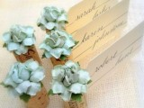 wine corks with fabric blooms and cards are an elegant and chic idea for wedding decor