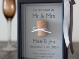 the couple's first toast and a wine cork attached in the frame – a cork from that bottle