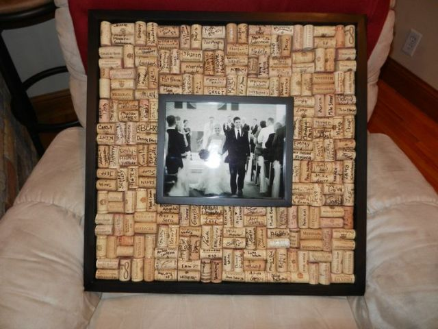 a wedding photo in a frame surrounded with wine corks is a fun and cool vineyard wedding idea