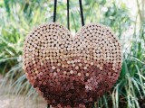 a large ombre wine cork heart is a gorgeous wedding decor idea – you may also use it as a sign