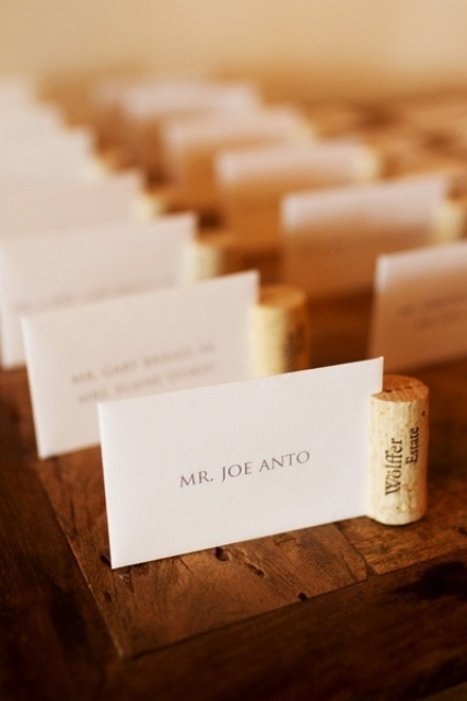 a seating chart done with wine corks and with cards is a fun and cute idea for a vineyard wedding