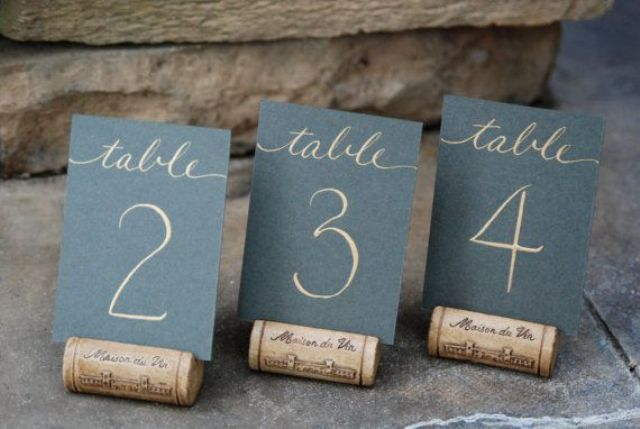 chalkboard table numbers placed on wine corks is a cool and simple idea to go for