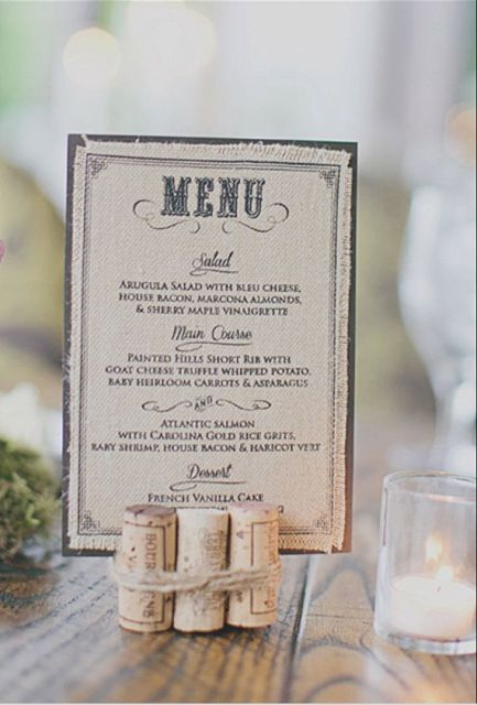 secured wine corks that hold a menu is a cool idea to style your reception tables