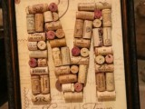 a wine cork monogram in a refined frame is a stylish and easy decoration idea for a vineyard wedding