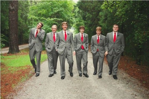 groomsmen wearing grey suits with red ties look very stylish and elegant