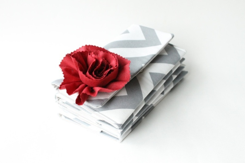 a grey and white chevron clutch with a red bloom for a bride or bridesmaids