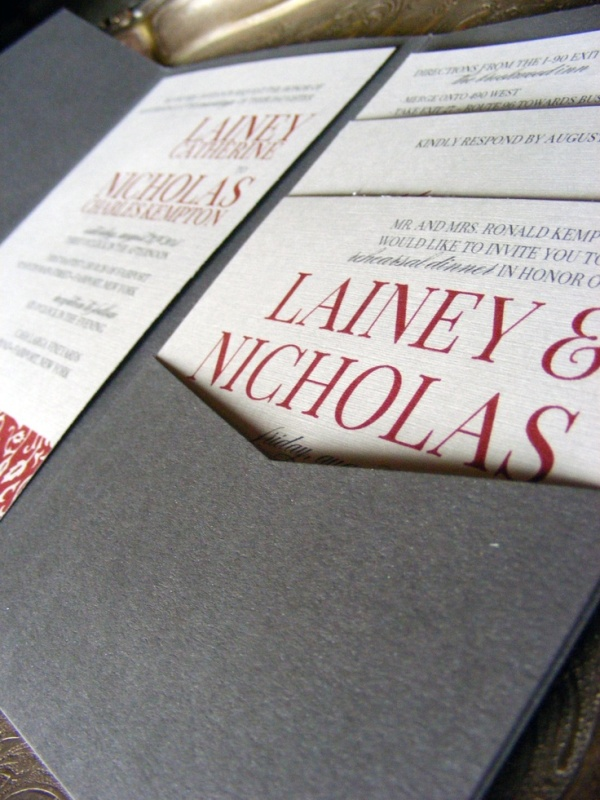 a grey, white and red wedding invitation suite is elegant and bold