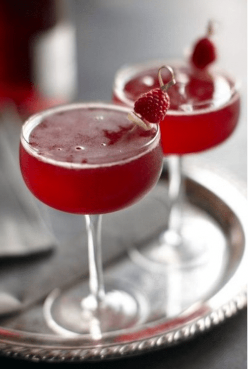 red signature drinks spruced up with little raspberries are amazing for a red and grey winter wedding