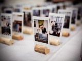 Polaroids put into wine cork stands are a cool idea for weddign escort cards or to spruce up the table decor