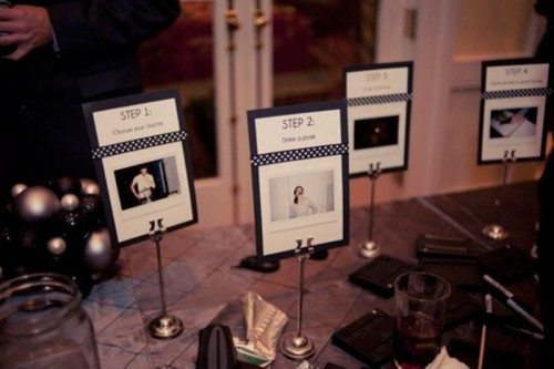 simple and cute wedding decorations of Polaroids on stands is a very chic and bold idea