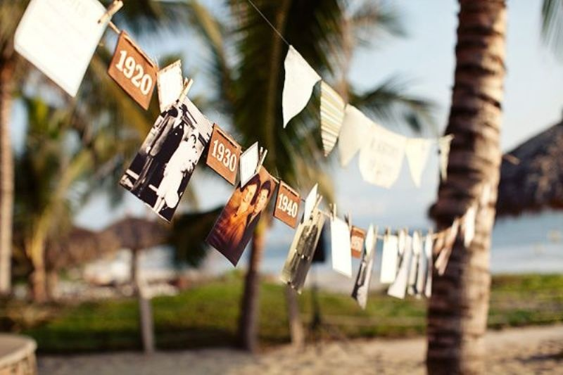 make garlands of your Polaroids and add touches that you like   this will be great personalized decor for the venue