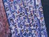 a seating chart made with numbers and Polaroids of the guests – DIY one yourself with no problems