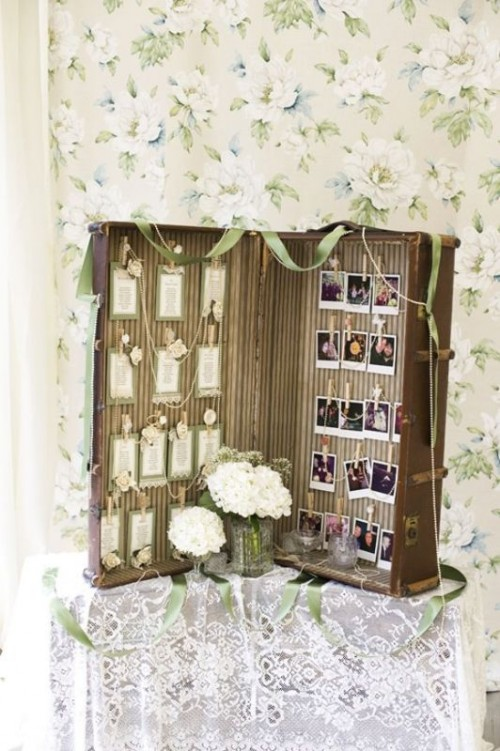 a suitcase with Polaroids of your couple and some cards is a pretty decoration for a wedding