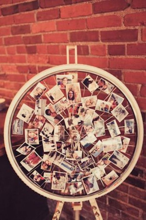 a large wheel with Polaroids attached is a cool rustic wedding decoration