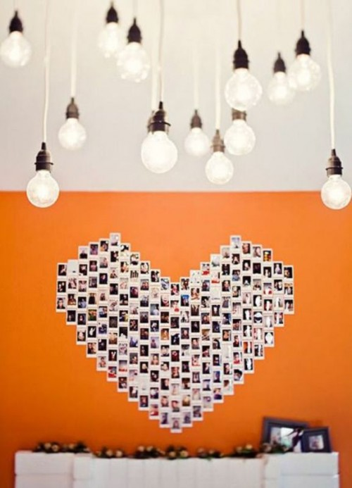 a large heart on the wall fully made of your couple's Polaroids is a very creative wedding or venue backdrop
