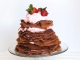 a chocolate crepe wedding cake with cream, strawberries and some pink cream on top is a gorgeous idea for your wedding