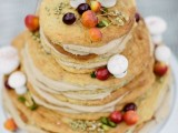 a woodland pancake wedding cake with nuts, seeds, grasses, sugar mushrooms and berries is a gorgeous idea for the fall