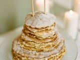 a classy pancake wedding cake with sugar powder and with a catchy paper bunting cake topper is a lovely idea for a small wedding