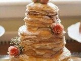 a crepe wedding cake with cream and pink blooms is a gorgeous and delicious solution for your wedding