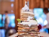 a pancake wedding cake with cream, fresh berries, mint and lovely couple cake toppers is a gorgeous idea to rock