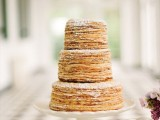 a simple yet refined crepe wedding cake with sugar powder is a lovely idea for a stylish spring or summer wedding