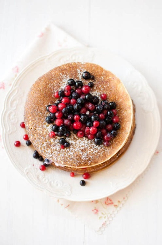 a pancake wedding cake topped with fresh berries and sugar powder is a lovely idea for a woodland or garden wedding