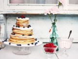 a pancake wedding cake with sugar powder, berries is a lovely idea for a summer wedding, you can DIY it