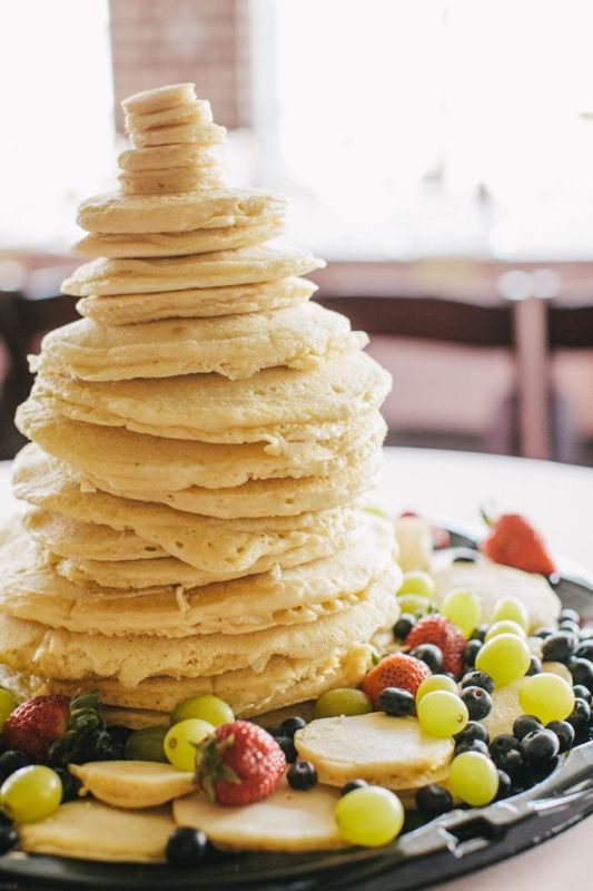 a super simple pancake wedding cake with lots of fresh fruit and berries around and nothign else is a very creative idea for those who don't liek much sugar