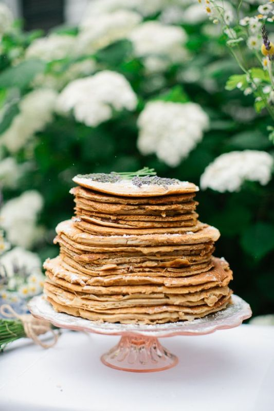 a pancake wedding cake with cream and some lavender on top is a lovely idea for a modern and relaxed wedding, in spring and summer