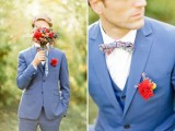 a bright blue three-piece wedding suit, a colorful bow tie, a red floral boutonniere for a contrasting and fun look