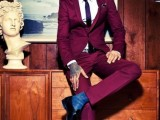 a fuchsia suit, a white shirt and a purple tie, black shoes are a bold combo for a daring groom