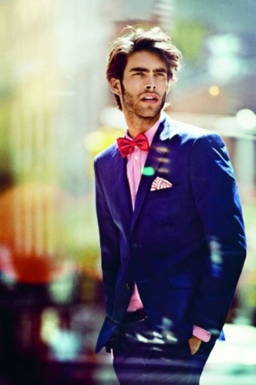 a bold blue suit, a pink shirt, a red bow tie and a printed handkerchief for a fun groom's look