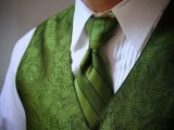 a white shirt, a patterned green waistcoat and a matching tie to express the personal style of the groom