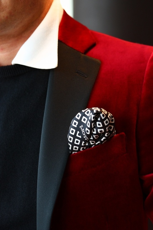 a bright red velvet tuxedo with black lapels, a white shirt and a black jumper to show off the unique style