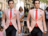 a peachy blazer, a white shirt and a red tie plus black pants for a super dapper and bold look