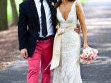pink pants, a white shirt, a black blazer and tie plus navy sneakers for a bold and unique groom's look