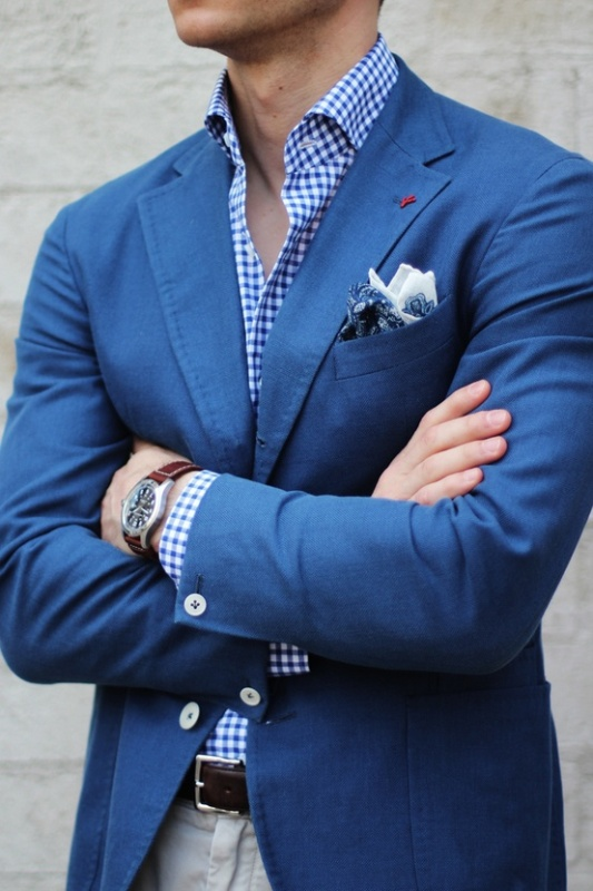 a bold blue jacket, a plaid shirt and printed handkerchiefs for a stylish and relaxed summer groom's look