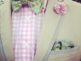 a neutral suit, a plaid pink shirt, a colorful printed bow tie and a green handkerchief for a spring or summer look