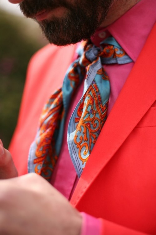 a hot red suit, a hot pink shirt and a bright printed necktie for a unique groom's outfit