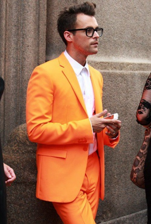 a bright orange suit, a white shirt and a white tie will help you make a statement at the wedding
