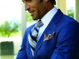 a bold blue suit, a striped shirt and a bright striped tie for a chic and bold groom's look