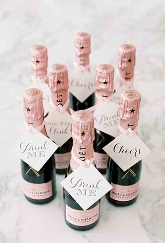 mini Moet Chandon bottles with tags are cool wedding favors that will make everyone happy