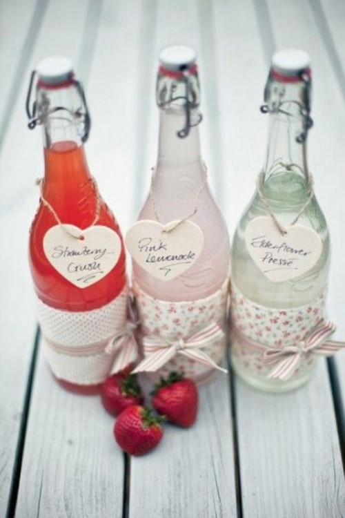fresh lemonade bottles with cute tags are cool drinkable wedding favors for a spring or summer wedding