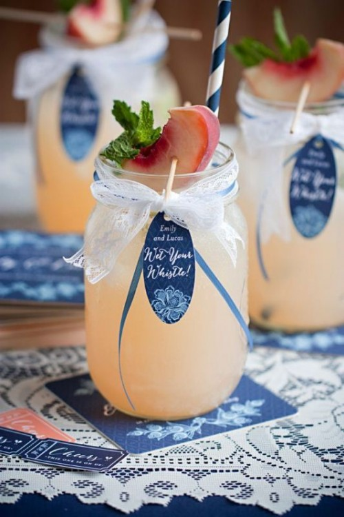 peach lemonade with peaches and fresh mint, with tags and straws are perfect for refreshing your guests in spring or summer