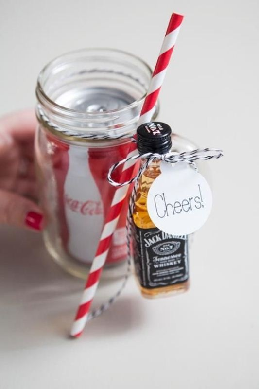 a jar with Coke and a small Jack Daniel's bottle to make a nice alcohol cocktail afterwards