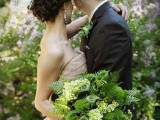 a textural wedding bouquet with ferns, green hydrangeas and seed pods for a lush woodland wedding